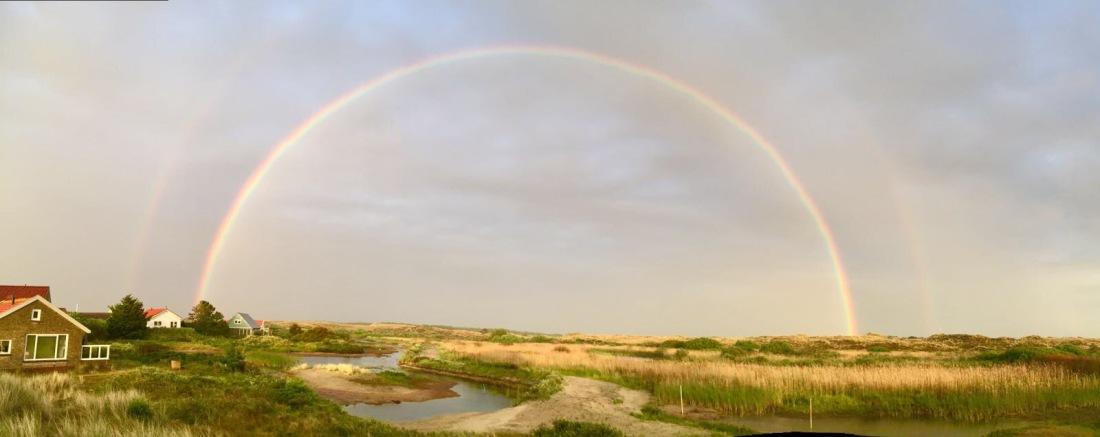Regenboog bij Midsland aan Zee
